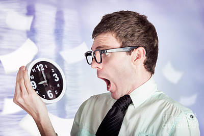 Stressed Male Office Worker Holding Overtime Clock Print by Jorgo Photography - Wall Art Gallery