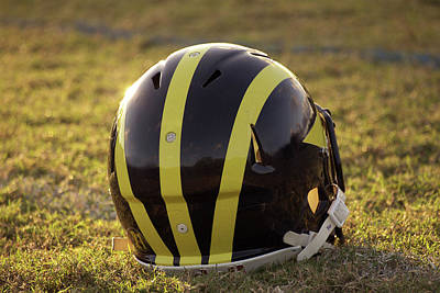 Photograph - Striped Wolverine Helmet On The Field At Dawn by Michigan Helmet