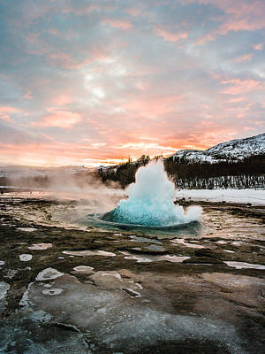 Photograph - Strokkur Winter Blowup In Front Of Sunset by Benjamin Wiedmann