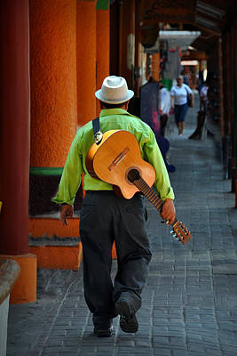 Photograph - Strolling Guitarist by Jim Walls PhotoArtist