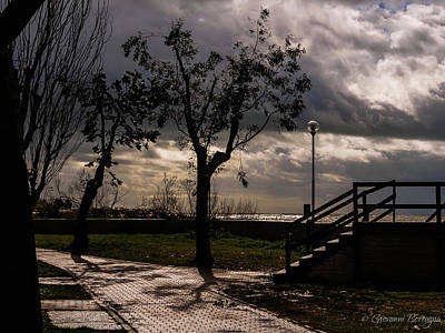 Photograph - Strolling The Waterfront On A Stormy Day by Giovanni Bertagna