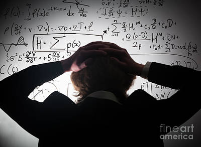Knowledge Photograph - Student Holding His Head Looking At Complex Math Formulas On Whiteboard by Michal Bednarek