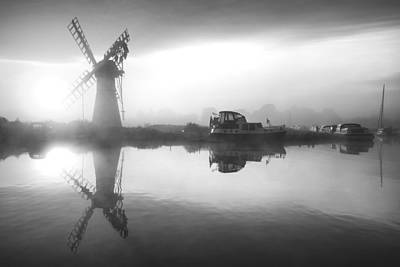 Architcture Photograph - Stunnnig Landscape Of Windmill And Calm River At Sunrise In Blac by Matthew Gibson