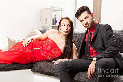 Stylish Young Couple On A Couch Art Print by Wolfgang Steiner