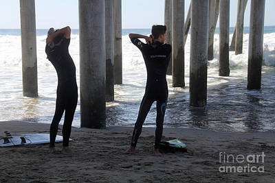 Photograph - Suiting Up Huntington Beach by Linda Queally