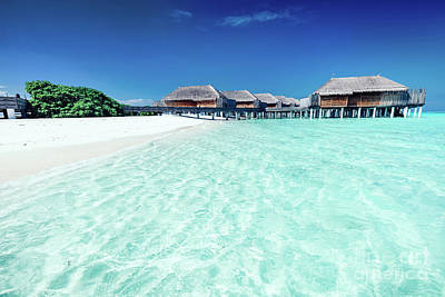 Photograph - Summer Hotel With Houses Standing In The Water On Maldives by Michal Bednarek