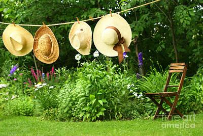 Summer Straw Hats Hanging On Clothesline Art Print by Sandra Cunningham
