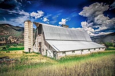 Kim Fearheiley Photography - Summer sunset with a red barn in rural Montana and Rocky Mountai by Alex Grichenko