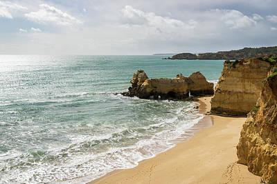 Photograph - Sun Clouds And Rough Landforms At A Beach In Algarve Portugal by Georgia Mizuleva