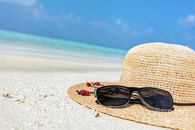 Photograph - Sun Hat And Sunglasses On Sand, Clear Turquoise Ocean In Maldives. by Michal Bednarek