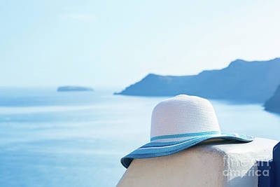 Sea Photograph - Sun Hat On White Stone Wall On Santorini Island, Greece. Travel, Tourism by Michal Bednarek