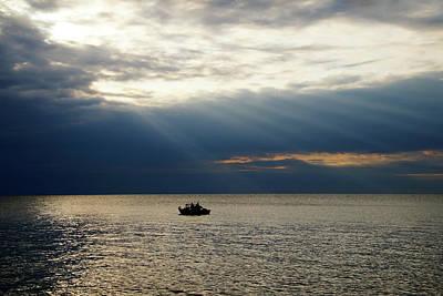 Photograph - Sun Rays Over Fishermen by Mike Murdock