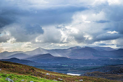 Art Print featuring the photograph Sun Rays Piercing Through The Clouds Touching The Irish Landscap by Semmick Photo