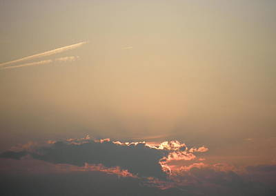 Photograph - Sun Setting Behind The Clouds by Kate Gallagher