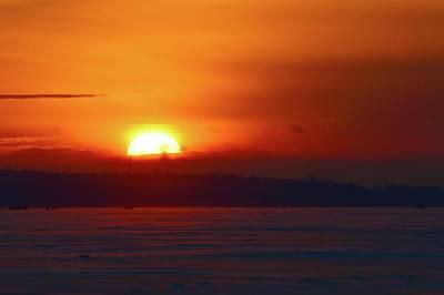 Photograph - Sun Setting Behind A Cloud  by Lyle Crump