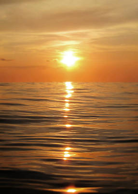 Sun Setting Over Calm Waters Art Print