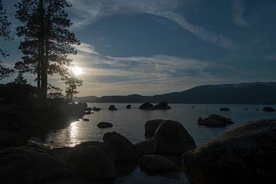 Photograph - sun setting over the mountains at Lake Tahoe by Dan Friend