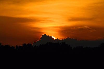 Photograph - Sun Sinking Behind The Clouds by Kathryn Meyer