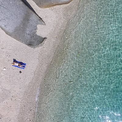 Photograph - Sunbathing On Beach In Whitsundays by Keiran Lusk