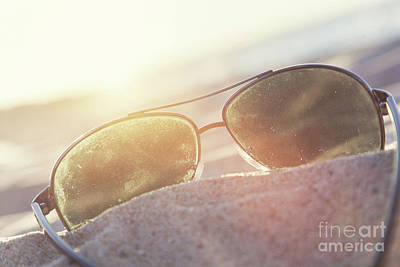 Ray Photograph - Sunglasses On Sand At Sunset, Beach And Ocean In The Background. by Michal Bednarek