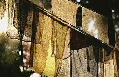 Sunlight Filters Through Prayer Flags Art Print by Michael Melford