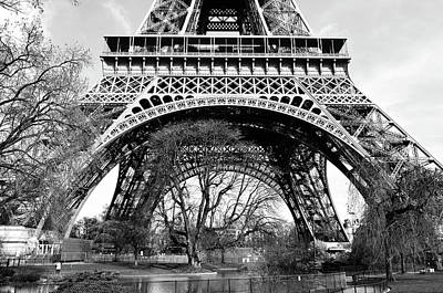 Photograph - Sunlit Base And First Floor The Eiffel Tower In Early Springtime Paris France Black And White by Shawn O'Brien