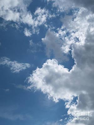 Photograph - Sunlit Clouds by Ann Horn