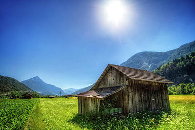 Photograph - Sunlit Farm In The Alps by Debra and Dave Vanderlaan