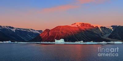 Thomas Kinkade Rights Managed Images - Sunrise in Scoresbysund, Greenland Royalty-Free Image by Henk Meijer Photography