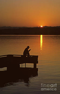Photograph - Sunrise Man Silhouetted Fishing Off Dock by Jim Corwin