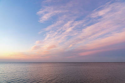 Photograph - Sunrise Moonset - Feathery Clouds And Crescent Moon Over Water by Georgia Mizuleva