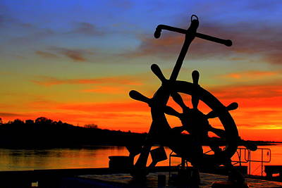 Photograph - Sunrise Over The Captain's Wheel by Suzanne DeGeorge