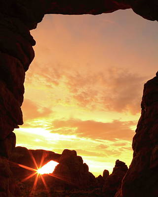 Photograph - Sunrise Starburst At Arches National Park by Roupen  Baker