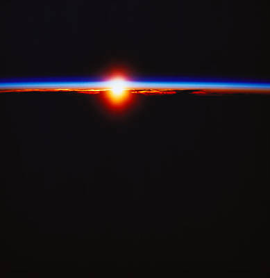 Illuminated Photograph - Sunrise Viewed From Space by Stockbyte