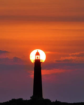 Photograph - Sunset At The Lighthouse by Laurie Hasan
