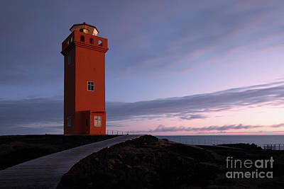 Photograph - Sunset at the lighthouse by Paolo Sirtori