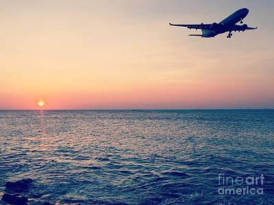 Klm Photograph - Sunset Landing by Jennifer Ansier