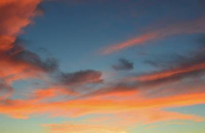 Photograph - Sunset Light On The Clouds  by Lyle Crump