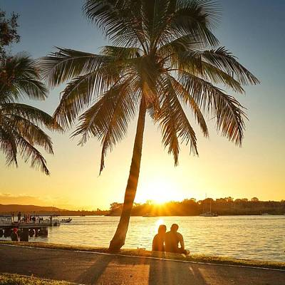 Photograph - Sunset Lovers Under Palm Tree And Down By The River by Keiran Lusk