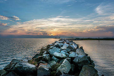 Animals Royalty-Free and Rights-Managed Images - Sunset over a rock jetty on the Chesapeake Bay by Patrick Wolf