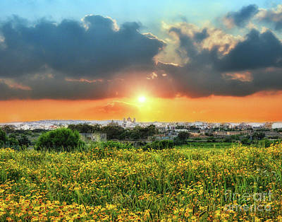 Sunset Over A Small Village Art Print by Stephan Grixti