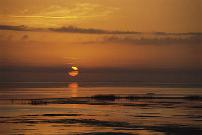 Natural Forces Photograph - Sunset Over Lake Okeechobee by Medford Taylor