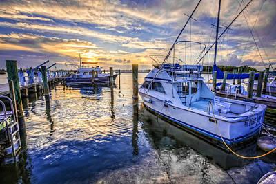 Sunset Over The Docks Art Print by Debra and Dave Vanderlaan