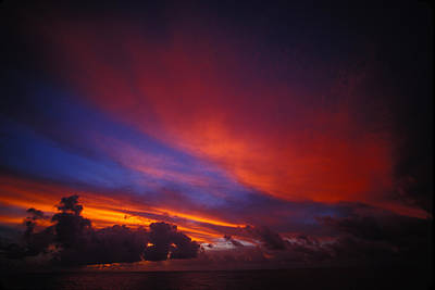 Sunset Over The Ocean Art Print by Nick Norman