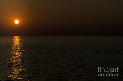 Photograph - Sunset Over The Sea by Wendy Wilton