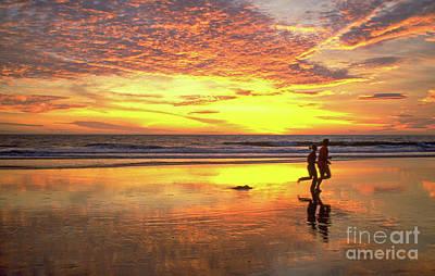 Photograph - Sunset Runners by David Zanzinger