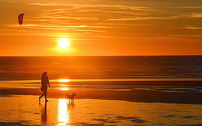 Photograph - Sunset Stroll On The Beach by AJ Schibig