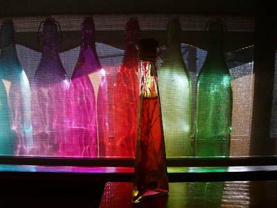Sunset Through Glass Bottles Art Print by Adrianne Wood
