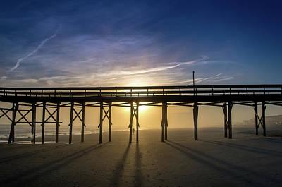 Photograph - Sunset Through The Pier by Gerald Monaco