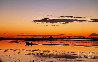 Photograph - Sunset With Boat At Chobe River, Botsuana by Wibke W